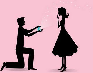 Man on knees proposing with a ring