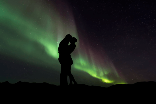 Couple kissing in dark